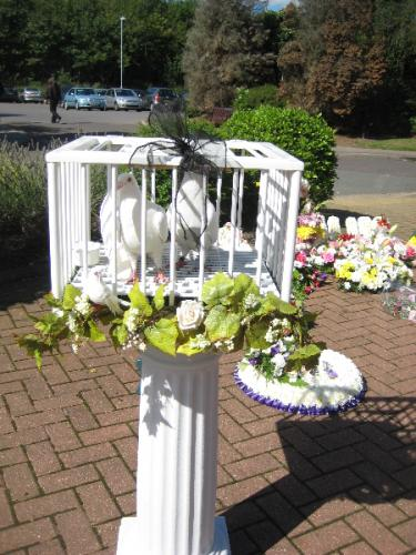 small-flock-sat-on-column-for-funeral
